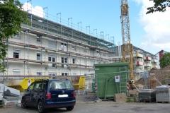 Sanierung und Aufstockung von 10 Wohngebäuden der Stadtbau